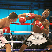 Henry Lebron lands a shot to the upper body of Ronnie Jordan during a Telemundo boxing match between at Osceola Heritage Park on Friday, February 23, 2018 in Kissimmee, Florida.  (Alex Menendez via AP)