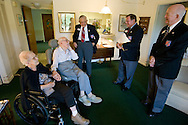 World War I Veteran Harry Landis, 107, at home in Sun City Center.  Landis is one of only four known surviving veterans of WWI.  Landis is pictured with his 99-year-old wife, Eleanor, and three retired officers from the Military Officers Association of America, Lt. Col. Paul Wheat, Maj. Jerry Foppe and Cmdr. Ed Socha.