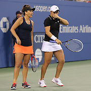 Casey Dellacqua, (left), and Ashleigh Barty, Australia, in action against Andrea Hlavackova, and Lucie Hradecka, Czech Republic, during the Women's Doubles Final at the US Open. Flushing. New York, USA. 7th September 2013. Photo Tim Clayton