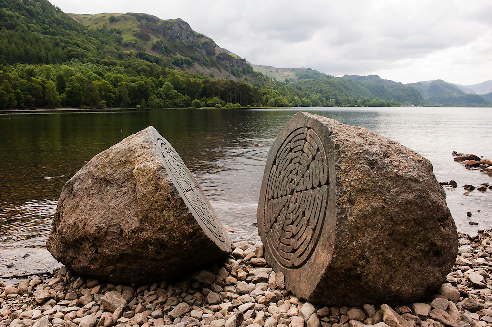 CALFCLOSE BAY, UK - JUN 10: Centenary Stone, Calfclose Bay, Lake District National Park, Cumbria, UK on June 10, 2012. The stone was carved inside by Peter Randall-Page to commemorate the National Trust's centenary in 1995.