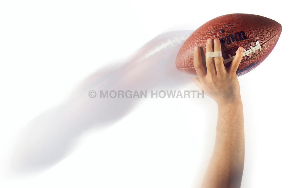 Arm throwing football with action