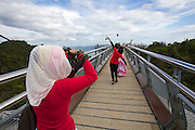 Panorama Langkawi. SkyBridge. Muslim girls taking souvenir photos.