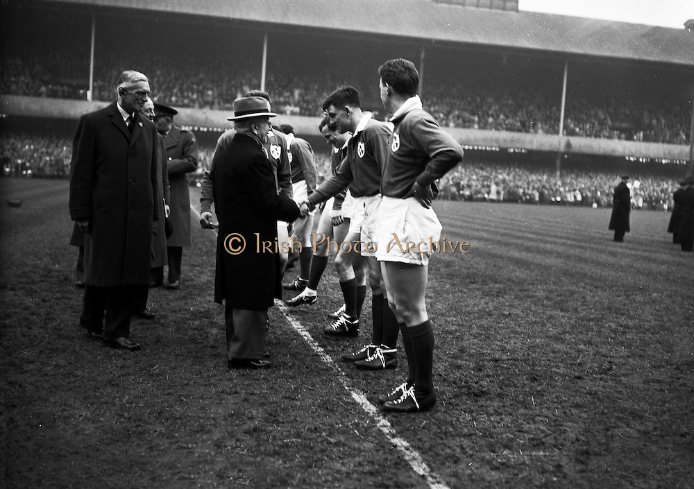 The President of Ireland, Sean Thomas O'Kelly, greeting N A Murphy, Cork Constitution, ..Irish Rugby Football Union, Ireland v England, Five Nations, Landsdowne Road, Dublin, Ireland, Saturday 14th February, 1959,.14.2.1959, 2.14.1959,..Referee- D Gwynne Walters, Welsh Rugby Union, ..Score- Ireland 0 - 3 England, ..Irish Team, ..N J Henderson, Wearing number 15 Irish jersey, Full back, N.I.F.C, Rugby Football Club, Belfast, Northern Ireland,..N H Brophy, Wearing number 14 Irish jersey, Right wing, University College Dublin Rugby Football Club, Dublin, Ireland, ..A J O'Reilly, Wearing number 13 Irish jersey, Right Centre, Old Belvedere Rugby Football Club, Dublin, Ireland, and, Leicester Rugby Football Club, Leicester, England, ..J F Dooley, Wearing  Number 12 Irish jersey, Left Centre, Galwegians Rugby Football Club, Galway, Ireland, ..A C Pedlow, Wearing number 11 Irish jersey, Left wing,  C I Y M S Rugby Football Club, Belfast, Northern Ireland, ..M A English, Wearing number 10 Irish jersey, Outside Half, Bohemians Rugby Football Club, Limerick, Ireland,..A A Mulligan, Wearing number 9 Irish jersey, Scrum Half, London Irish Rugby Football Club, Surrey, England, ..B G Wood, Wearing number 1 Irish jersey, Forward, Garryowen Rugby Football Club, Limerick, Ireland, ..A R Dawson, Wearing number 2 Irish jersey, Captain of the Irish team, Forward, Wanderers Rugby Football Club, Dublin, Ireland, ..S Millar, Wearing number 3 Irish jersey, Forward, Ballymena Rugby Football Club, Antrim, Northern Ireland,..W A Mulcahy, Wearing number 4 Irish jersey, Forward, University College Dublin Rugby Football Club, Dublin, Ireland, ..M G Culliton, Wearing number 5 Irish jersey, Forward, Wanderers Rugby Football Club, Dublin, Ireland, ..N A Murphy, Wearing number 6 Irish jersey, Forward, Cork Constitution Rugby Football Club, Cork, Ireland,..P J A O' Sullivan, Wearing  Number 7 Irish jersey, Forward, Galwegians Rugby Football Club, Galway, Ireland,..J R Kavanagh, Wearing number 8 Irish