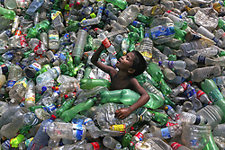 October 1, 2018 - Dhaka, Bangladesh - A child worker drinks out of a plastic bottle at a recycling factory at Mohammadpur. (Credit Image: © Kazi Salahuddin Razu/NurPhoto/ZUMA Press)