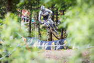 Mark Wallace takes flight during his race run at the UCI Mountain Bike World Cup in Fort William.