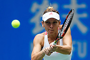 WUHAN, CHINA - SEPTEMBER 28: <br /> <br /> Simona Halep of Romania returns a shot during the women\'s singles third round match against Yaroslava Shvedova of Kazakhstan on day four of the 2016 WTA Dongfeng Motor Wuhan Open at Optics Valley International Tennis Center on September 28, 2016 in Wuhan, China.<br /> ©Exclusivepix Media
