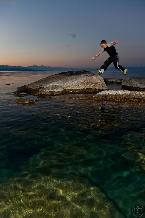 """Boy at Lake Tahoe 4"" - This boy was photographed near Speedboat Beach, Lake Tahoe,  jumping from rock to rock at sunrise."