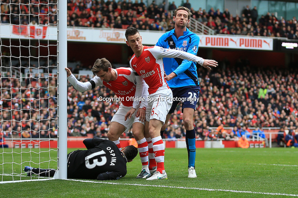 11 January 2015 - Barclays Premier League - Arsenal v Stoke City - Laurent Koscielny and Nacho Monreal of Arsenal place themselves between Goalkeeper, David Ospina and Peter Crouch of Stoke City - Photo: Marc Atkins / Offside.