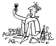 (A man holding up a glass of wine is sitting surrounded by empty glasses and bottles)