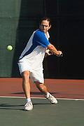 Tennis Player Hitting Backhand