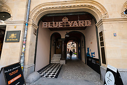Entrance to Blue Yard courtyard containing cafes and fashion boutiques and shops in Mitte Berlin Germany