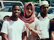 Jose Padilla, also known as Abdullah al Muhajir, (C) poses with unidentified classmates outside the Dural Uloom Institute in Pembroke Pines, Florida, in this undated photograph. Padilla, who took Koranic studies classes at the Islamic center between 1995 and 1997, was arrested May 8, 2002 by the United States government and is being held as an enemy combatant. HANDOUT PHOTO COPIED BY:COLIN BRALEY