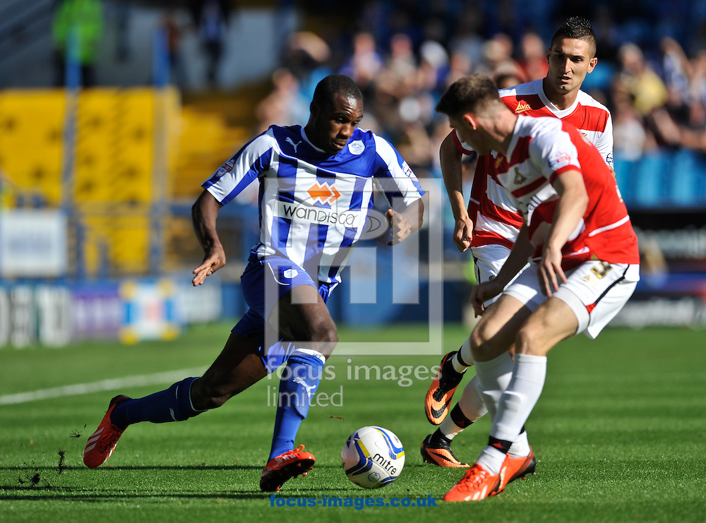 Picture by Richard Land/Focus Images Ltd +44 7713 507003<br /> 28/09/2013<br /> Michail Antonio of Sheffield Wednesday takes on the Doncaster Rovers defence during the Sky Bet Championship match at Hillsborough, Sheffield.