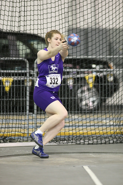 Windsor, Ontario ---12/03/09--- Cara Marcantonio of  the University of Western Ontario competes in the Women's Weight Throw at the CIS track and field championships in Windsor, Ontario, March 12, 2009..Sean Burges Mundo Sport Images