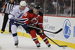 Feb 9; Newark, NJ, USA; New Jersey Devils left wing Zach Parise (9) skates with the puck while being defended by Tampa Bay Lightning defenseman Eric Brewer (2) during the first period at the Prudential Center.