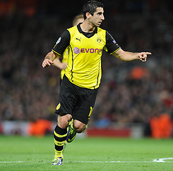 Borrusia Dortmund's Henrik Mkhitaryan celebrates the first goal of the game. - Photo mandatory by-line: Alex James/JMP - Tel: Mobile: 07966 386802 22/10/2013 - SPORT - FOOTBALL - Emirates Stadium - London - Arsenal v Borussia Dortmund - CHAMPIONS LEAGUE - GROUP F
