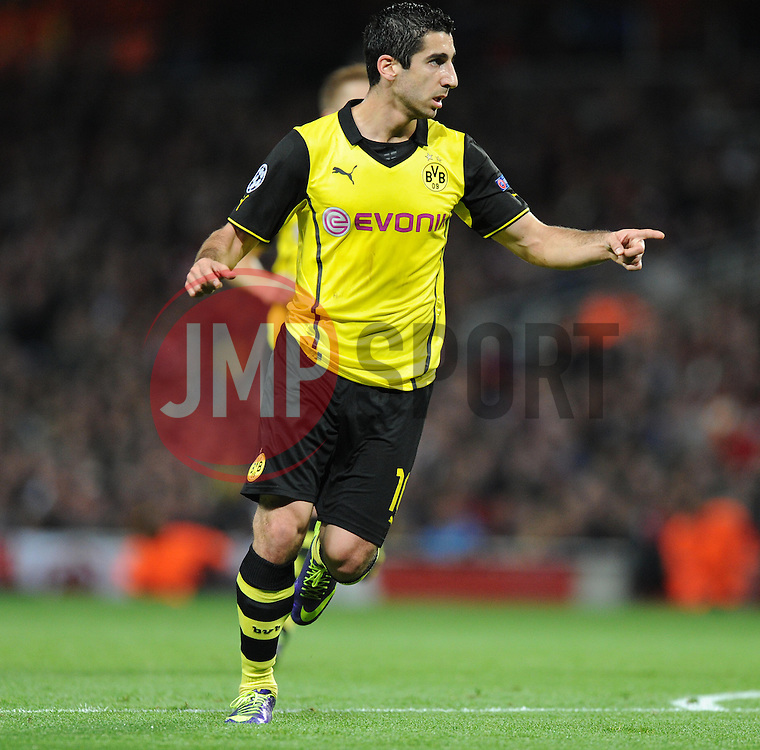 Borrusia Dortmund's Henrik Mkhitaryan celebrates the first goal of the game. - Photo mandatory by-line: Alex James/JMP - Tel: Mobile: 07966 386802 22/10/2013 - SPORT - FOOTBALL - Emirates Stadium - London - Arsenal v Borussia Dortmund - CHAMPIONS LEAGUE - GROUP F