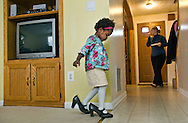 After a final court appearance to make her adoption legal, Ila Yslande Ann Hubner, who was born in Haiti, takes a spin in her aunt's shoes Thursday, January 20, 2011 in Frederick, MD.  The adoption process was expedited for the Frederick family after the devasting earthquake damaged the orphanage last year.