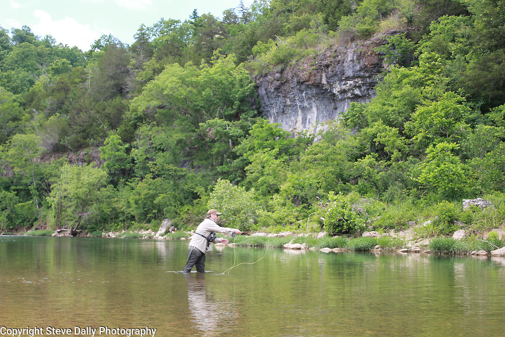Fly Fishing underneath the Ozark's famous limestone Bluffs on Crooked Creek Arkansas for smallmouth bass.