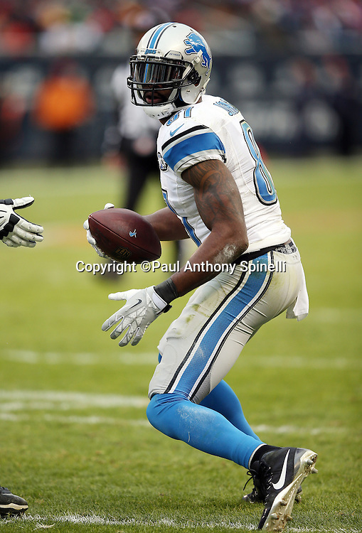 Detroit Lions wide receiver Calvin Johnson (81) looks for running room after catching a pass for a first down deep in Chicago Bears territory during the NFL week 17 regular season football game against the Chicago Bears on Sunday, Jan. 3, 2016 in Chicago. The Lions won the game 24-20. (©Paul Anthony Spinelli)