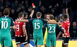 Tottenham Hotspur goalkeeper Hugo Lloris (third right) is sent-off by match referee Slavko Vincic (third left)