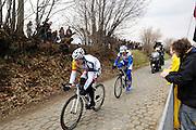 Belgium, March 31 2013: Andre Greipel, Lotto Belisol, leads Laurens de Vreese from TOPSPORT VLAANDEREN-BALOISE on the Oude-Kwaremont climb during the elite men's Ronde van Vlaandaren 2013 cycle race. Copyright 2013 Peter Horrell.
