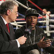 Boxer and promoter Floyd Mayweather is seen getting interviewed by a Showtime announcer during Showtime Televisions ShoBox:The Next Generation boxing match at the Event Center at Turning Stone Resort Casino on Friday, February 28, 2014 in Verona, New York.  (AP Photo/Alex Menendez)