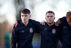 BANGOR, WALES - Saturday, November 17, 2018: Wales' Dylan Levitt (L) and Daniel Griffiths stand for the national anthem before the UEFA Under-19 Championship 2019 Qualifying Group 4 match between Sweden and Wales at the Nantporth Stadium. (Pic by Paul Greenwood/Propaganda)