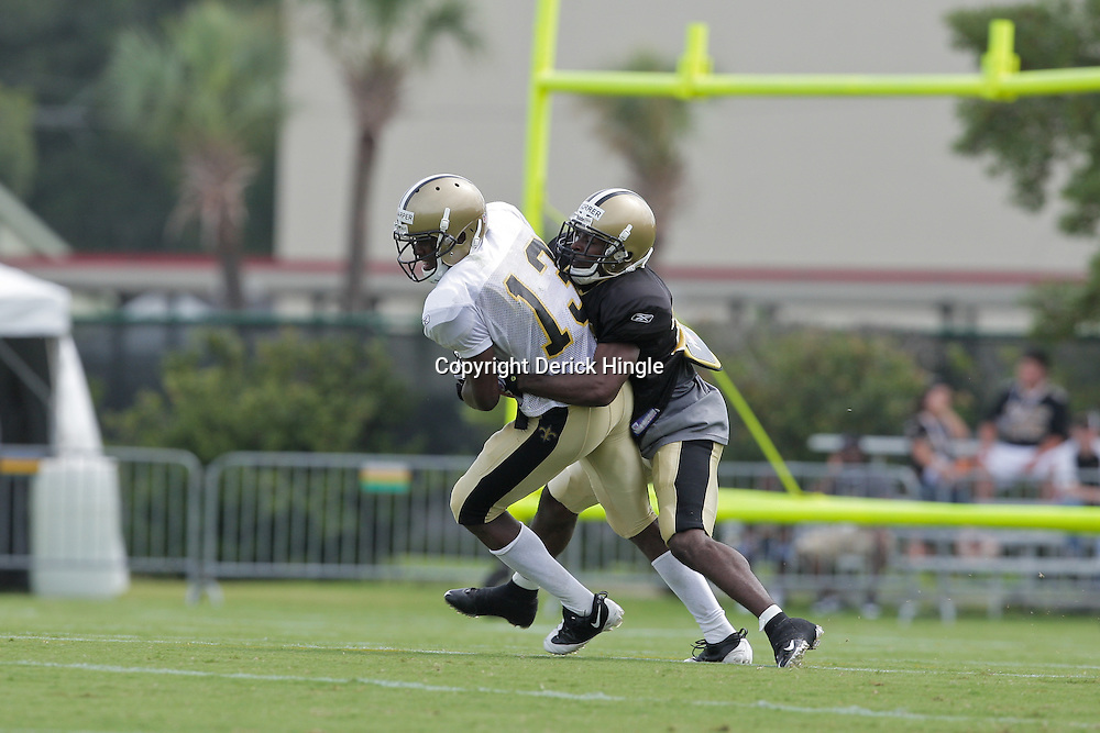 31 July 2009: New Orleans Saints cornerback Danny Gorrer (38) tackles receiver, Rod Harper (13) during a drill on the opening day of New Orleans Saints training camp held at the team's practice facility in Metairie, Louisiana.