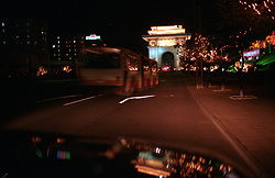 """Pyongyang, North Korea, April/May 2004. Pyongyang by night. In the back the """"Arc of Triumph""""<br /> The Arc of Triumph was erected in 1982 'to glorify the Heroic Exploits of President Kim Il Sung who returned home in triumph after liberating the country'.<br /> The Arc is 60 meters high, just a bit bigger than the Arc de Triumph in Paris.  (Photo by Teun Voeten) *** Please Use Credit from Credit Field ***"""