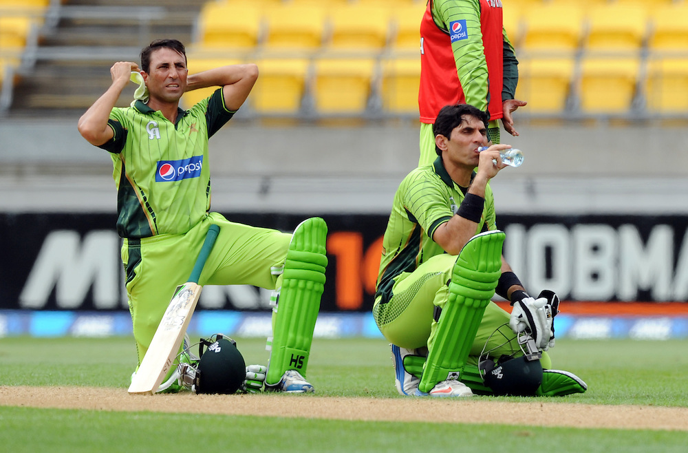Pakistan's Younis Khan, left, awaits a DRS decision with Misbah-ul-Haq against New Zealand in the 1st One Day International cricket match at Westpac Stadium, New Zealand, Saturday, January 31, 2015. Credit:SNPA / Ross Setford