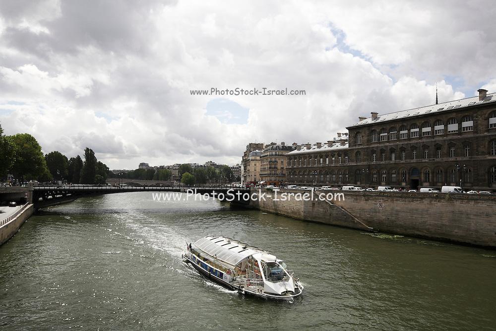 France, Paris Tourist river bus travelling along the Seine