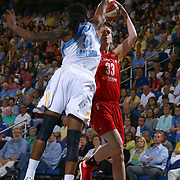 Washington Mystics Center Emma Meesseman (33), right, attempts the outside jumper as Chicago Sky Forward Jessica Breland (51) defends in the second half of an WNBA preseason basketball game between the Chicago Sky and the Washington Mystics Tuesday, May. 13, 2014 at The Bob Carpenter Sports Convocation Center in Newark, DEL