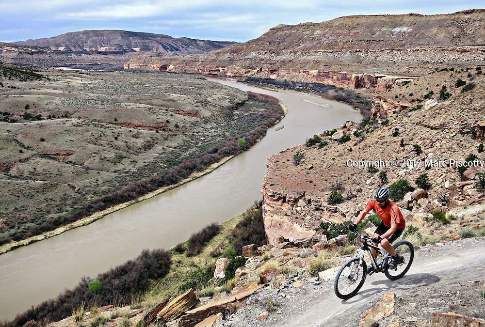 SHOT 4/5/12 1:49:02 PM - Doug Pensinger of Denver, Co. mountain biking Mary's Loop with a view of the Colorado River near Fruita, Colo . The City of Fruita is a Home Rule Municipality located in the western part of Mesa County, Colorado, in the United States. The area surrounding Fruita is renowned for its mountain biking trail system. (Photo by Marc Piscotty / © 2012)