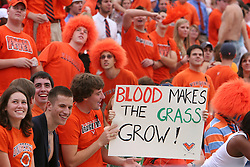 "Virginia students hold up a sign that reads ""Blood Makes the Grass Grow"" at a college football game.  The Virginia Cavaliers defeated the Duke University Blue Devils 38-7 on September 24, 2005 at Scott Stadium in Charlottesville, VA."