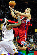 Feb. 11, 2011; Cleveland, OH, USA; Los Angeles Clippers power forward Blake Griffin (32) shoots over Cleveland Cavaliers point guard Mo Williams (2) during the fourth quarter at Quicken Loans Arena. The Cavaliers broke their loosing streak beating the Clipper 126-119 in overtime. Mandatory Credit: Jason Miller-US PRESSWIRE