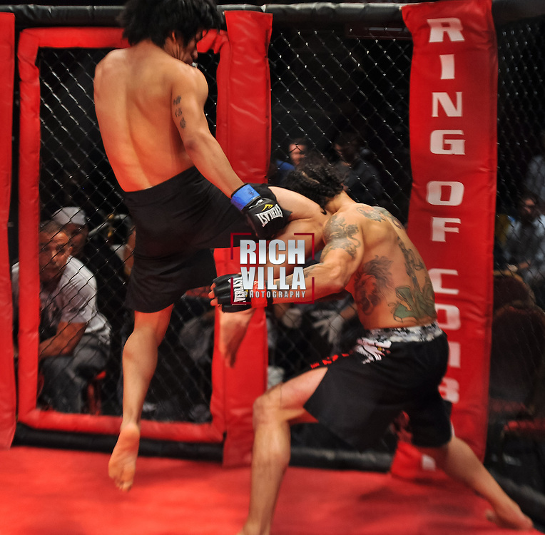 Atlantic City, New Jersey, January 24, 2014: Leodegario Muniz(left) lands a right knee on Jose Villanueva's(right) right ear casuing him to go down at Ring of Combat 47 at The Tropicana Casino.