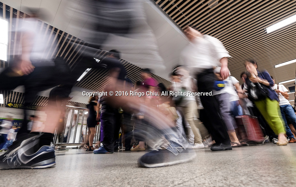 People rush to work and school at subway station on Monday morning in Shanghai, China. Shanghai is the most populous city in China and the most populous city proper in the world. It is one of the four direct-controlled municipalities of China, with a population of more than 24 million as of 2014. It is a global financial centre, and a transport hub with the world's busiest container port. Located in the Yangtze River Delta in East China, Shanghai sits on the south edge of the mouth of the Yangtze in the middle portion of the Chinese coast. The municipality borders the provinces of Jiangsu and Zhejiang to the north, south and west, and is bounded to the east by the East China Sea. A major administrative, shipping, and trading town, Shanghai grew in importance in the 19th century due to trade and recognition of its favourable port location and economic potential. The city was one of five forced open to foreign trade following the British victory over China in the First Opium War while the subsequent 1842 Treaty of Nanking and 1844 Treaty of Whampoa allowed the establishment of the Shanghai International Settlement and the French Concession. The city then flourished as a center of commerce between China and other parts of the world (predominantly Western countries), and became the primary financial hub of the Asia-Pacific region in the 1930s. However, with the Communist Party takeover of the mainland in 1949, trade was limited to socialist countries, and the city's global influence declined. In the 1990s, the economic reforms introduced by Deng Xiaoping resulted in an intense re-development of the city, aiding the return of finance and foreign investment to the city. Shanghai has been described as the &quot;showpiece&quot; of the booming economy of mainland China; renowned for its Lujiazui skyline, museums and historic buildings, such as those along The Bund, the City God Temple and the Yu Garden.(Photo by Ringo Chiu/PHOTOFORMULA.com)<br /> <br /> Usage Notes: This content is intended for e