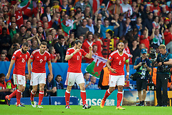 LILLE, FRANCE - Friday, July 1, 2016: Wales' captain Ashley Williams celebrates scoring the first equalising goal against Belgium during the UEFA Euro 2016 Championship Quarter-Final match at the Stade Pierre Mauroy. (Pic by David Rawcliffe/Propaganda)