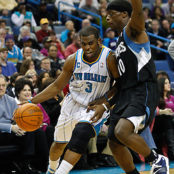 February 7, 2011; New Orleans, LA, USA; New Orleans Hornets point guard Chris Paul (3) drives past Minnesota Timberwolves point guard Jonny Flynn (10) during the second quarter at the New Orleans Arena.   Mandatory Credit: Derick E. Hingle