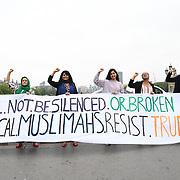 Huda Elmi,Fatima Rajina,Malia Bouattia, Maz Saleem,Zarah Sultana and Heena Khaled of Muslimahs Resist Trump upon his state visit to the UK, with a big banner hanging from Westminster Bridge, London (UK) on 12 July 2018.