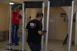 July 23, 2017 - Bethlehem, West Bank - Palestinians make home-made metal detectors and place them outside the Israeli- Palestinian barrier in protest of extra security added to Temple Mount. (Credit Image: © Louise Wateridge/Pacific Press via ZUMA Wire)
