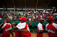 Santiago de Cuba players congratulate each other after winning game two of the National Series against Pinar del Rio, in Pinar del Rio, Cuba, on Sunday, April 20, 2008. ..When music and dancing are the rhythm and soul of life on this island nation, baseball is the passion. It gives Cubans something to dance to and something to cheer for when there's little else. It's what makes them feel free of government politics.