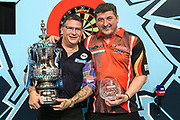 World Matchplay Champion 2018 Gary Anderson with runner up Mensur Suljovic during the BetVictor World Matchplay Darts 2018 final at Winter Gardens, Blackpool, United Kingdom on 29 July 2018. Picture by Shane Healey.