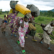 Displaced people return to their homes outside of Goma. Fighting escalated in recent weeks between the rebel group CNDP, the National Congress for the Defense of the People, and the Congolese army, displacing tens of thousands of people.