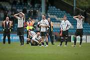 The Salford City players react to losing the penalty shoot out during the Vanarama National League North match between FC Halifax Town and Salford City at the Shay, Halifax, United Kingdom on 7 May 2017. Photo by Mark P Doherty.