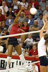 Stanford's Ogonna NNamani returns the ball with fury. The game and set was won by Stanford.  The match up took place at ISU's Redbird Arena in Normal Illinois on September 11, 2002.  The crowd was over 5600 and took the record for fans attending a volleyball game at Redbird, the MVC's record for number of fans watching a conference team and was the largest audience in the continental US thus far in the 2002 season<br />