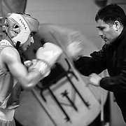 Antonio and Anthony warm up moments before the fight. Being his son's coach is bringing memories of his youth to Antonio, and he's happy that the circumstances are better for his son. (Oscar Aguirre)