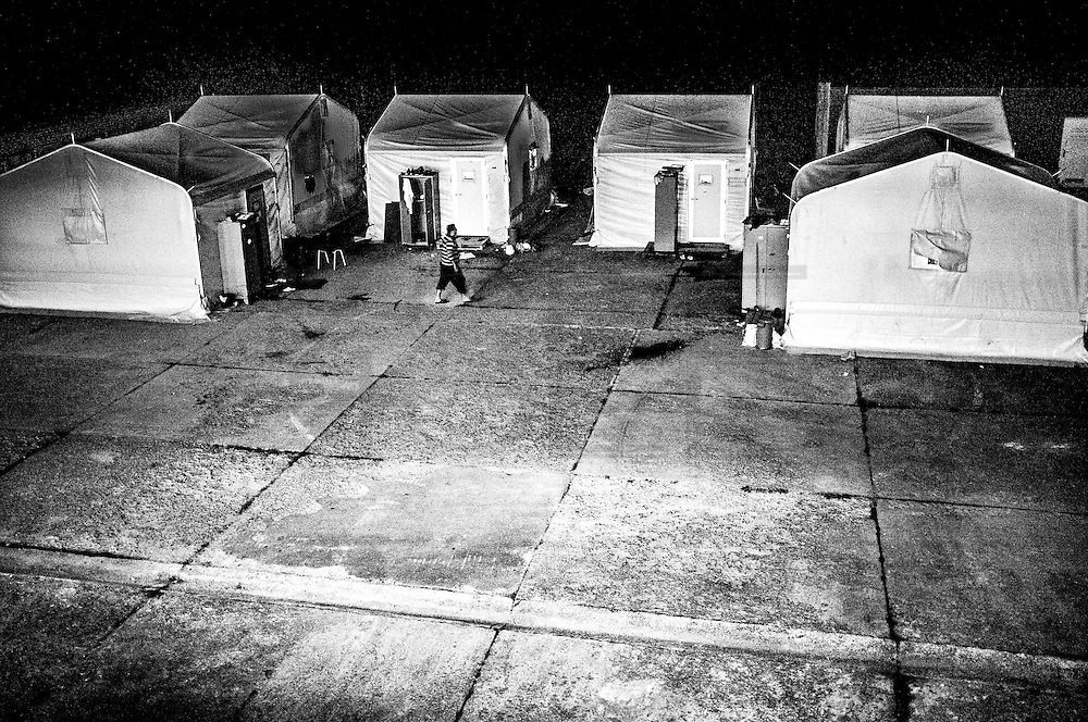 New military tents used as an emergency accommodation for the increasing number of incoming residents. FEDASIL Sugny asylum center. Sugny, Belgium. October 2015. I took these photographs during an international volunteer program that I liderate with an international volunteering group.