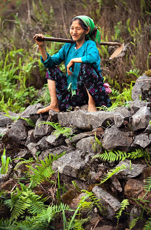 A woman working in the corn fields near Ha Giang, Vietnam.